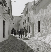 Calle real , with the shop ALMA on your right